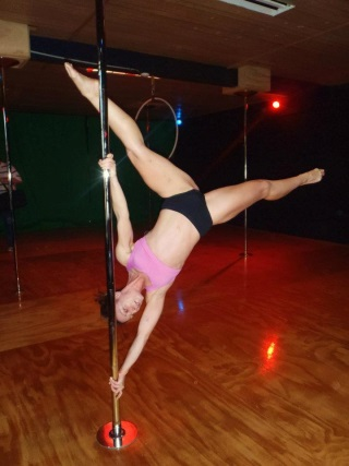Personal Trainer Cherie doing pole fitness